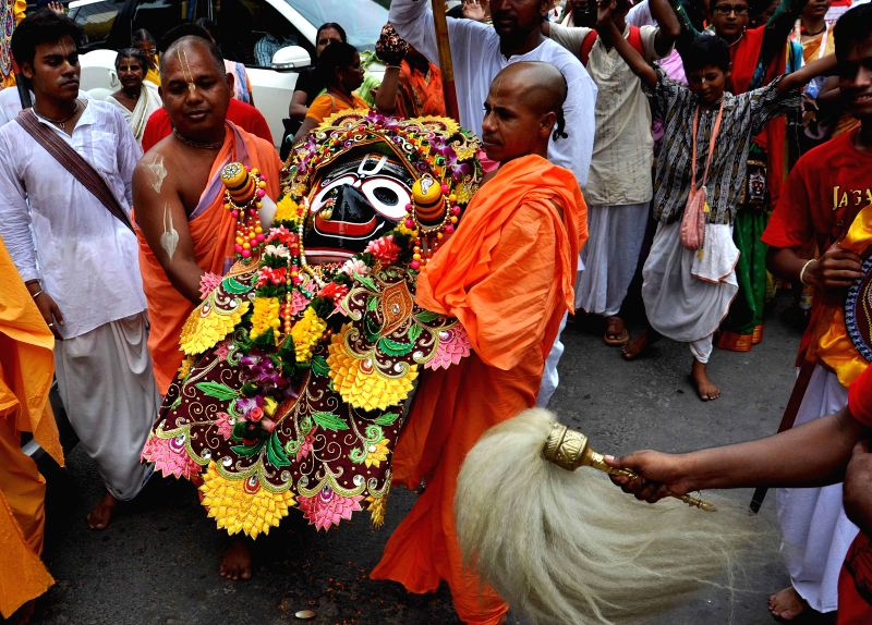 Devotees participate in a `rath yatra` (chariot procession) taken out by the ISKCON (International Society for Krishna Consciousness) in Kolkata on June 29, 2014.