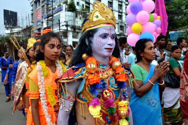 Devotees participate in a `rath yatra` (chariot procession) taken out by the ISKCON (International Society for Krishna Consciousness) in Guwahati on June 29, 2014.