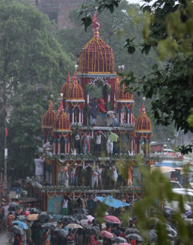 Devotees participate in a `rath yatra` (chariot procession) in Mahesh, 35 km away from Kolkata on June 29, 2014.