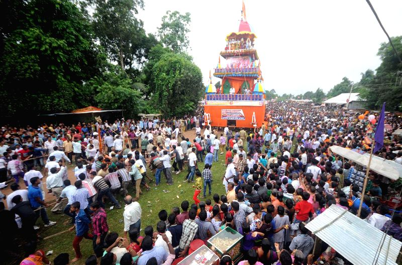 Devotees participate in a `rath yatra` (chariot procession) organised in Melaghar of Tripura's Sepahijala district on June 29, 2014.