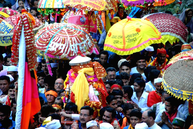 Devotees participate in Nanda Devi Raj Jaat Yatra at Nandkesari of Uttarakhand on Aug 27, 2014.