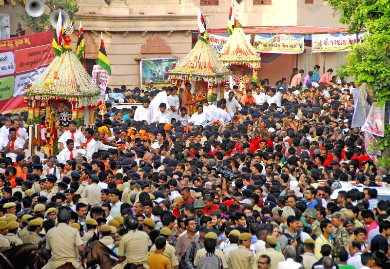 Devotees participate in `rath yatra` (chariot procession) in Ahmedabad on June 29, 2014.