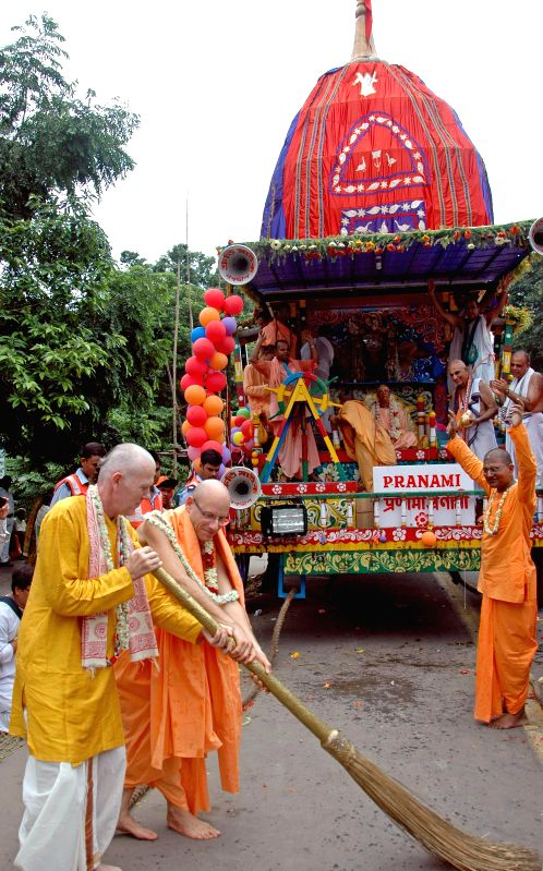 Devotees participate in Ulta RathYatra organised by International Society for Krishna Consciousness (ISKCON) in Kolkata on July 7, 2014.