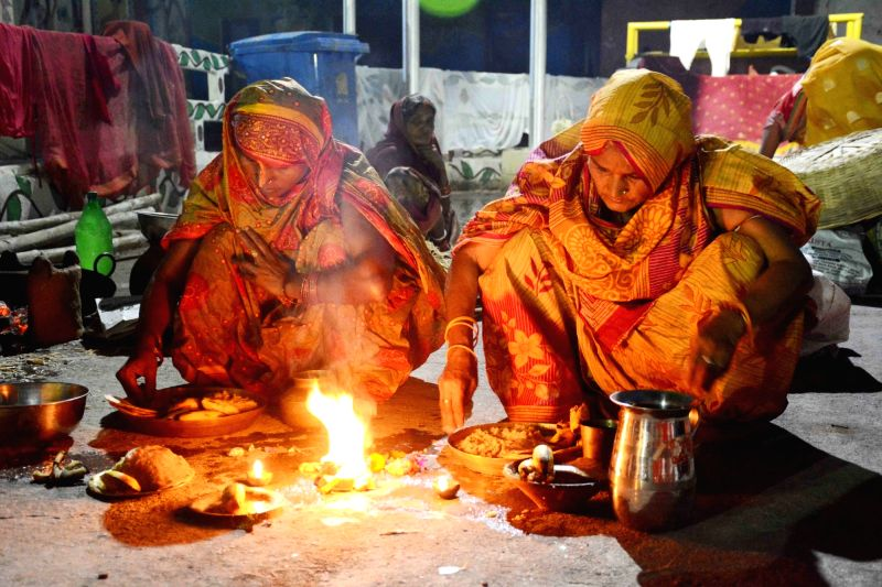 Devotees perform rituals during Chhath Puja celebrations in Patna