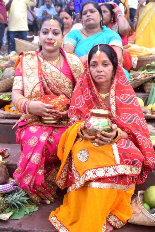 Devotees perform rituals on the banks of Ganga river during Chhath Puja celebrations