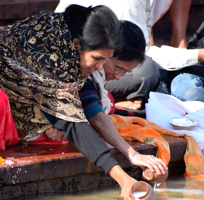 Devotees praying on Mithuna Sankranti