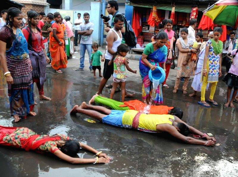 Devotees perform rituals on the eve of Bengali New Year, in Kolkata on April 14, 2018.