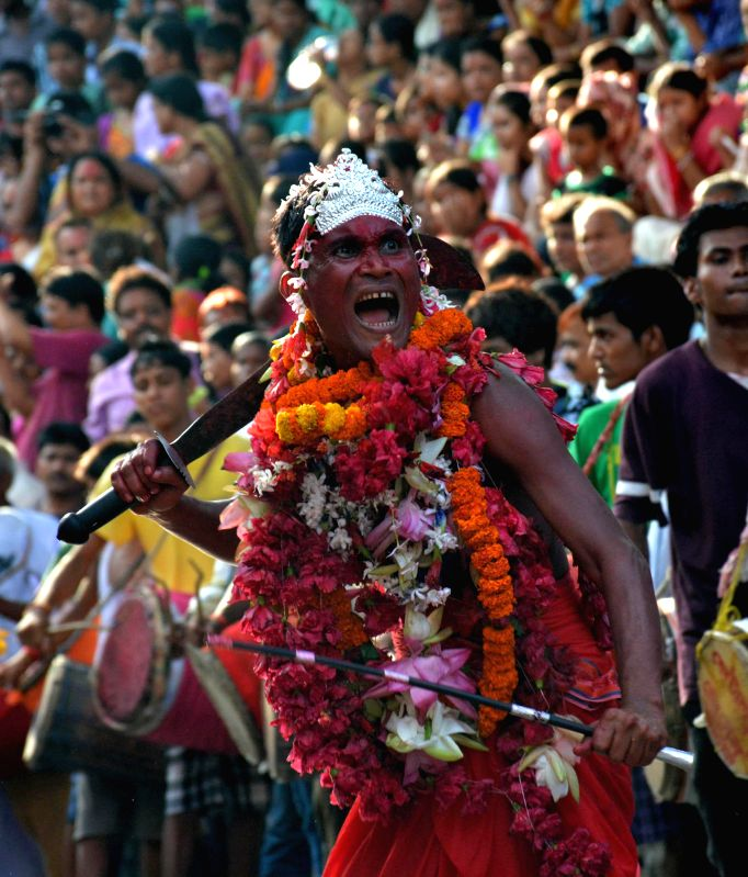 Devotees performs Deodhani nritya during Deodhani dance festival at Kamakhya Temple in Guwahati on Aug 18, 2014.