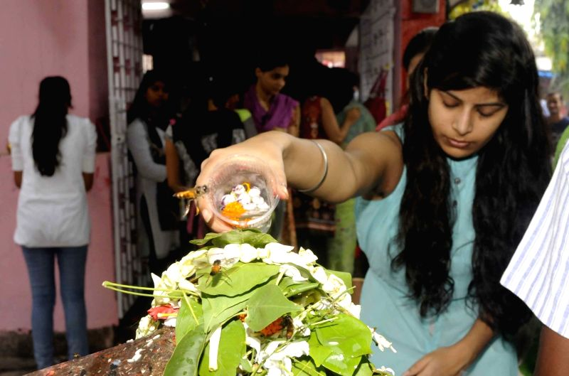 Devotees performs rituals to Lord Shiva on the first monday of Shravan month at Boring Road Shiv Mandir in Patna on July 25, 2016.