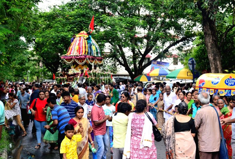 Devotees pull a chariot during Jagannath Rath Yatra, in Kolkata on July 14, 2018.