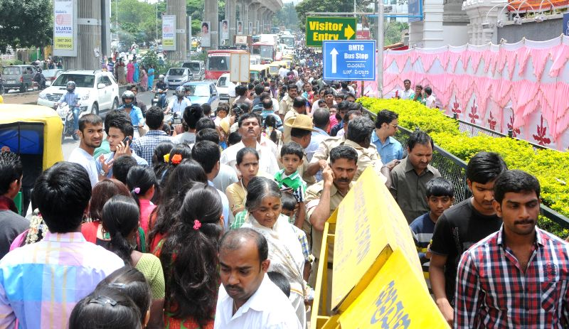 Devotees queue-up at ISKCON Temple on Krishna Janmastami in Bangalore on Aug 17, 2014.