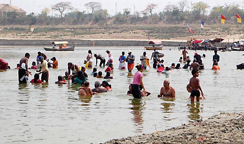 "Devotees take a holy dip in Sangam on ""Akshaya Tritiya"" in Allahabad, on May 9, 2016."