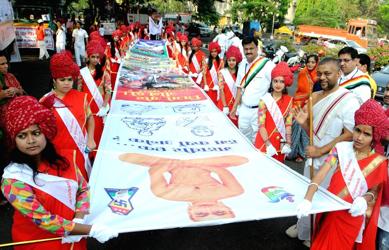 Devotees take part in a Shobha Yatra organised at Freedom Park to celebrate Mahaveer Jayanti in Bangalore on April 13, 2014.