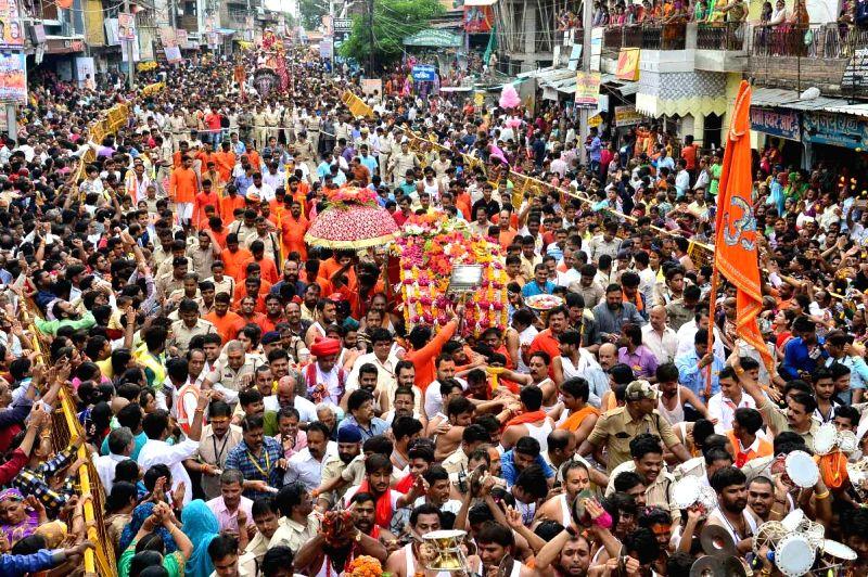 """Devotees take part in """"Mahakal Ki Sawari"""" processions on Sawan month in Ujjain on July 17, 2017."""