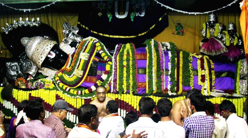 Devotees throng a temple on Vaikuntha Ekadashi in Bengaluru, on Jan 1, 2015.