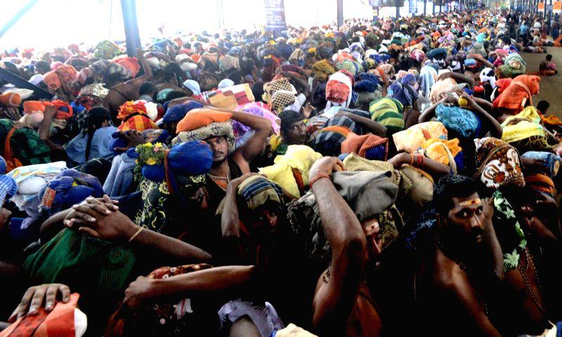 Devotees throng at Ayyappa Temple in Sabarimala, Kerala on Nov 30, 2015.