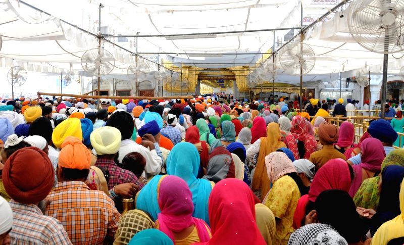 Devotees throng Golden Temple on the occasion of Baisakhi, in Amritsar on April 14, 2018.