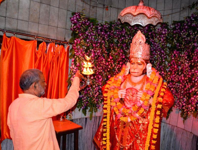 Devotees throng Hanuman Setu temple on 'Bada Mangal' in Lucknow on May 16, 2017.