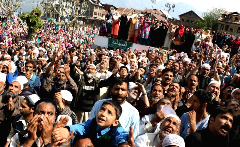 Devotees throng Hazratbal Shrine on the occasion of Shab e-Meraj which is observed to mark Prophet Mohammed's journey from the world; in Srinagar on April 14, 2018.