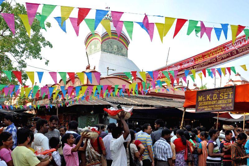 Devotees throng Kalighat temple during `Poila Baisakh` in Kolkata on April 15, 2014.