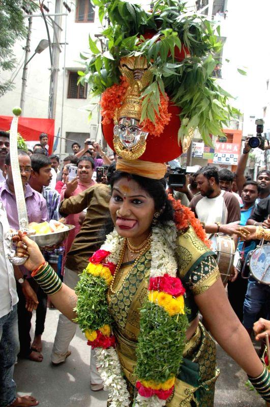 Devotees thronge the streets of Secunderabad on the occasion of Mahankali Bonalu Jatara also known as Lashkar Bonalu on July 17, 2016.