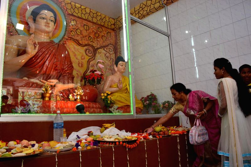 Devotees visit a monastery on 2558th birth anniversary of Lord Buddha in Guwahati on May 14, 2014. Buddha Purnima is the most sacred day in the Buddhist calendar and celebrated on the full-moon day ..