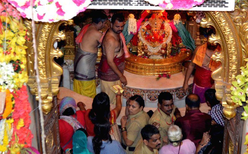 Devotees visit Siddhivinayak Temple on Angarki Sankashti Chaturthi in Mumbai, on June 13, 2017.
