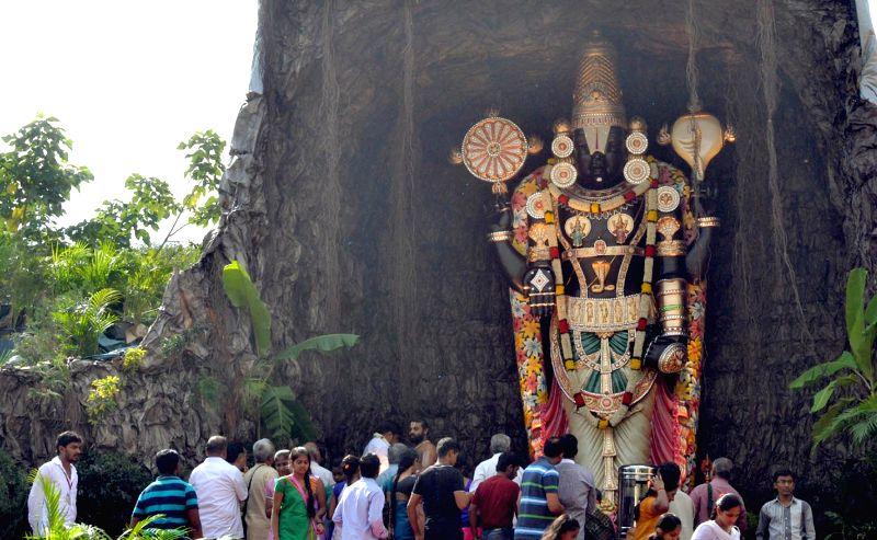 Devotees worship Balaji statue at Freedom Park on Krishna Janmastami in Bangalore on Aug 17, 2014.