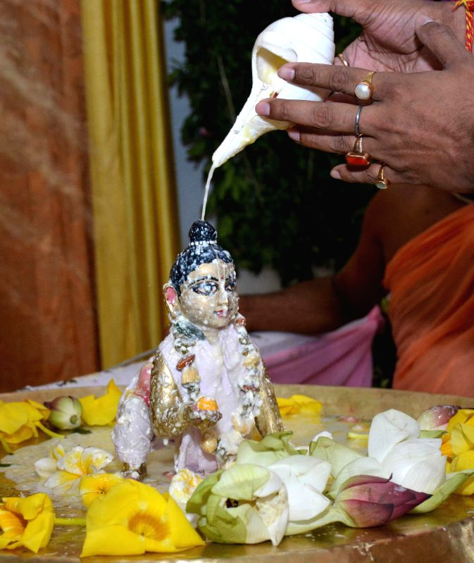 Devotees worships lord Krishna and Radha at ISKCON Temple on Janmashtami in Guwahati on Aug 18, 2014.
