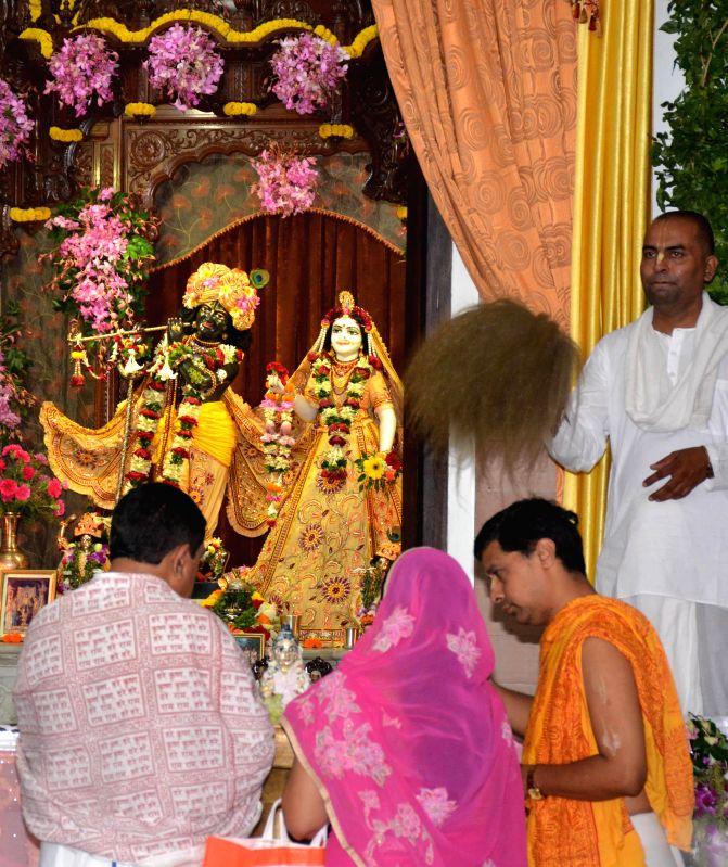 Devotees worships lord Krishna at ISKCON Temple on Janmashtami in Guwahati on Aug 18, 2014.