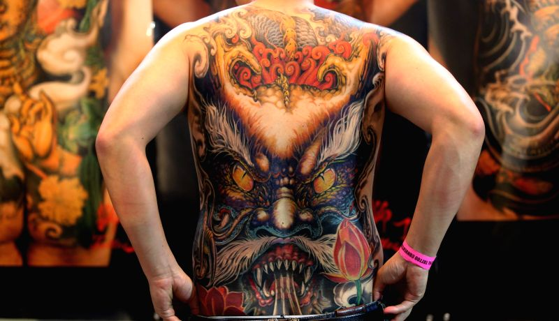 A man shows his tattoo during the 5th International Nepal Tattoo Convention organized in Kathmandu, Nepal, April 24, 2015. Over 150 tattoo artists from different ...