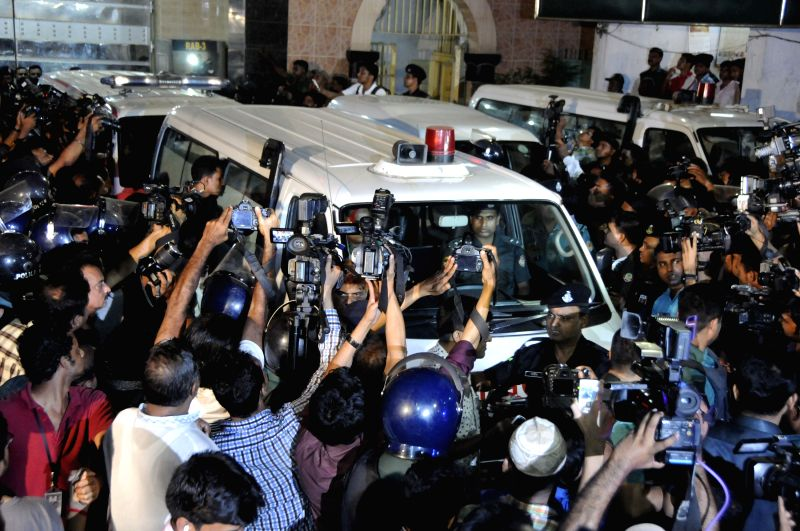 People surround an ambulance carrying the body of Muhammad Kamaruzzaman in Dhaka, Bangladesh, April 11, 2015. Bangladesh on Saturday night executed Muhammad ...