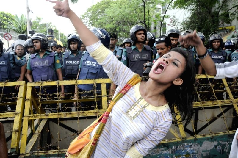 A Bangladeshi woman shouts slogans during a protest against sexual assaults on women during the celebration of Bengali New Year in Dhaka, Bangladesh, April 21, 2015. ...