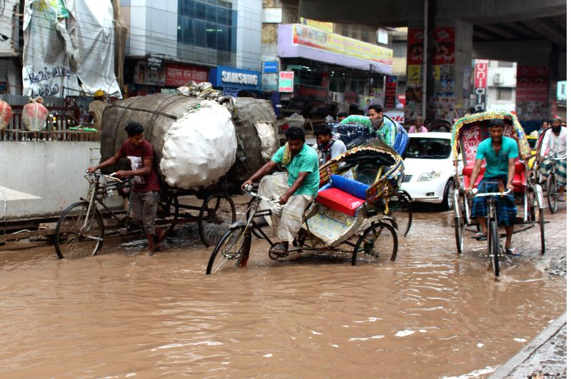 DHAKA, April 22, 2017 - Rickshaws pass through a waterlogged street in Bangladeshi capital Dhaka, on April 22, 2017.