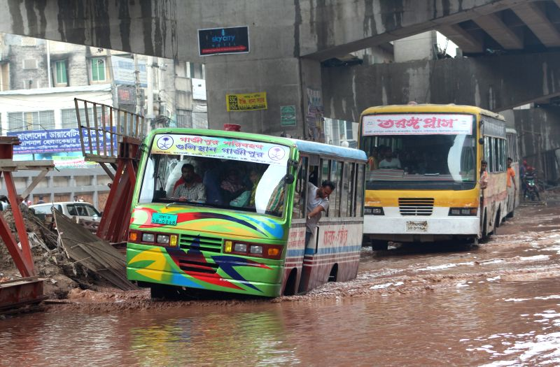 DHAKA, April 22, 2017 - Two buses pass through a waterlogged street in Bangladeshi capital Dhaka, on April 22, 2017.