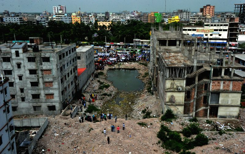 Picture taken on April 24, 2015 shows an aerial view of the site of the Rana Plaza building collapse on the second anniversary of the tragedy in Savar, on the ...