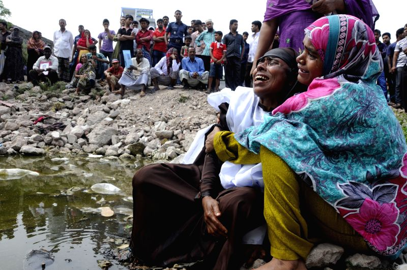 Relatives of the victims mourn at the site of the Rana Plaza building collapse on the second anniversary of the tragedy in Savar, on the outskirts of Dhaka, ...