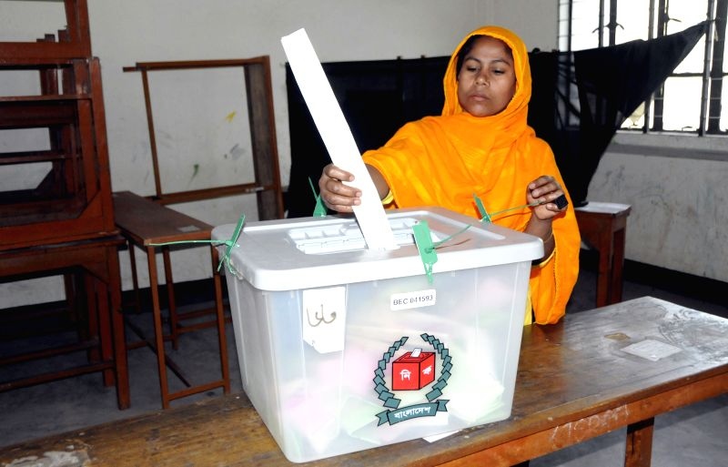 A Bangladeshi woman casts her vote at a polling station during the Bangladesh's city corporation and municipal polls in Dhaka, Bangladesh, April 28, 2015. Voting ...