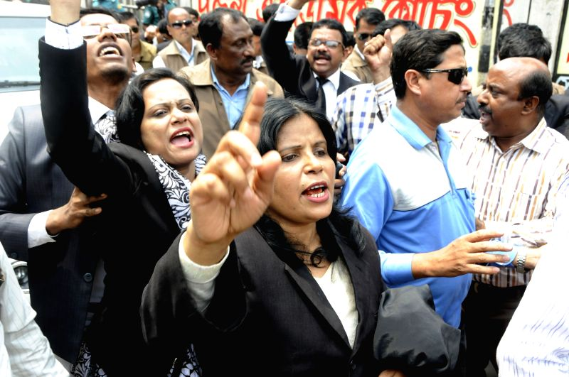 Supporters of Bangladesh Nationalist Party (BNP) shout slogans during a trial against Bangladesh's former Prime Minister and BNP leader Khaleda Zia in Dhaka, ... - Khaleda Zia