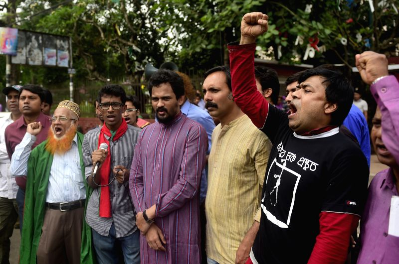Bangladeshi freedom fighters shout slogans after the review petition to a case of Jamaat-e-Islami party leader was rejected in Dhaka, Bangladesh, April 6, 2015. ...