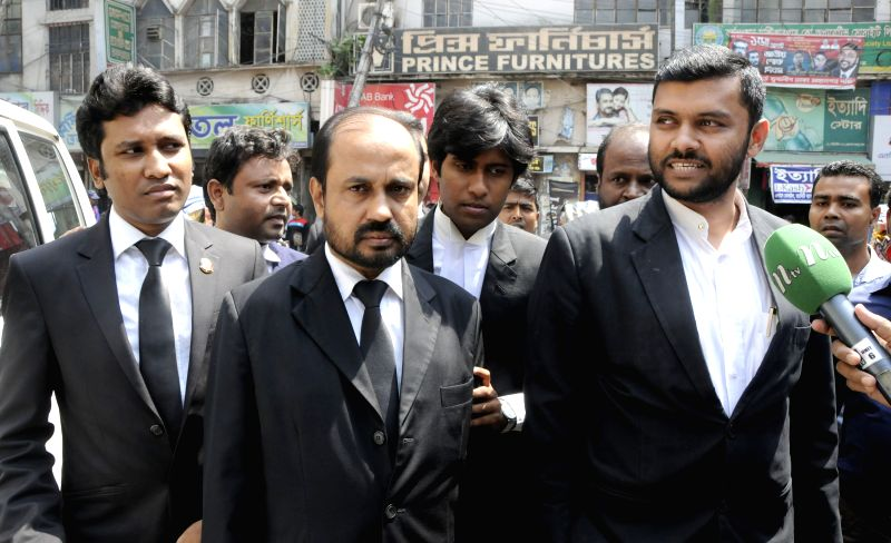 Lawyers of Mohammad Kamaruzzaman, the Jamaat-e-Islami party's assistant secretary general, talk to media outside the Central Jail in Dhaka, Bangladesh, April 9, 2015. ...