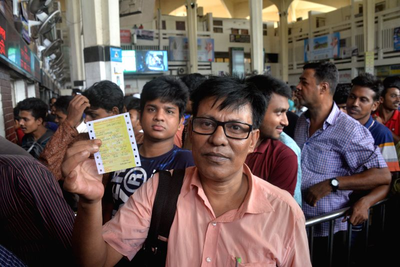 DHAKA, Aug. 11, 2018 - A man shows his ticket at Dhaka's central Kamalapur Railway Station, Bangladesh, on Aug. 11, 2018. As the holy Eid-ul-Azha, one of the largest Muslim religious festivals, drew ...