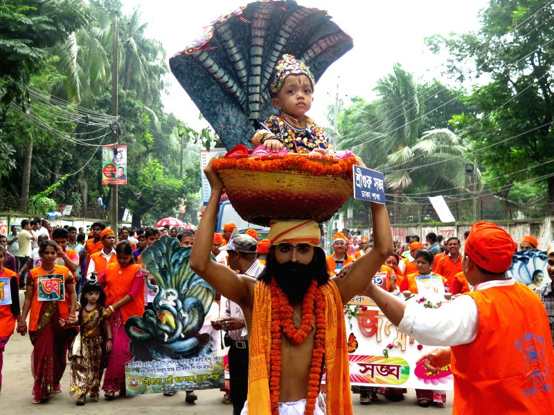 Bangladeshi Hindu people take part in the Krishna Janmashtami festival in Dhaka, Bangladesh, Aug. 17, 2014. The festival, which marks the birth of Lord Krishna, is ...