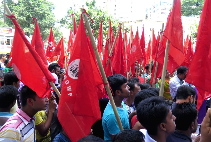 Workers of Toba garment factory take part in a rally in Dhaka, Bangladesh, on Aug. 29, 2014. Hundreds of garment workers demanded their factories reopen and pay them .