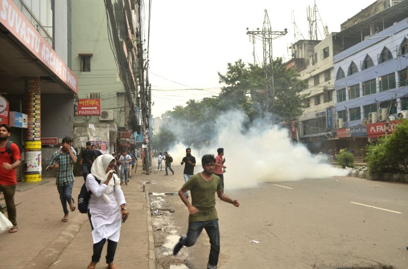 DHAKA, Aug. 5, 2018 - Students demonstrating for road safety run when chased by anti-riot policemen in Dhaka, Bangladesh on Aug. 5, 2018.