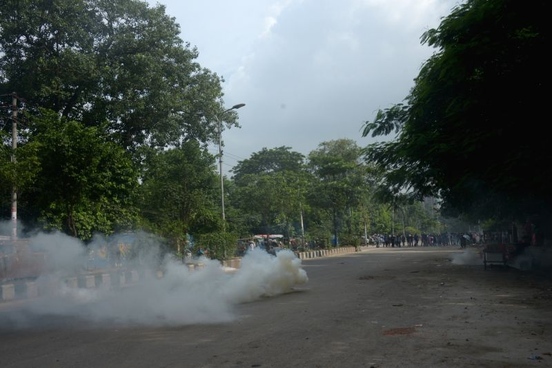 DHAKA, Aug. 6, 2018 - Police fire tear gas during a demonstration for road safety in Dhaka, Bangladesh on Aug. 6, 2018.