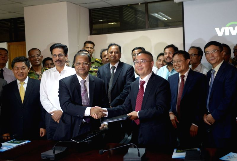 DHAKA, Aug. 8, 2016 - Amzad Hossain (L, Front), director general of Bangladesh Railway, shakes hands with Zhang Xuecai (R, Front), deputy general manager of China Railway Eryuan Engineering Group CO. ...