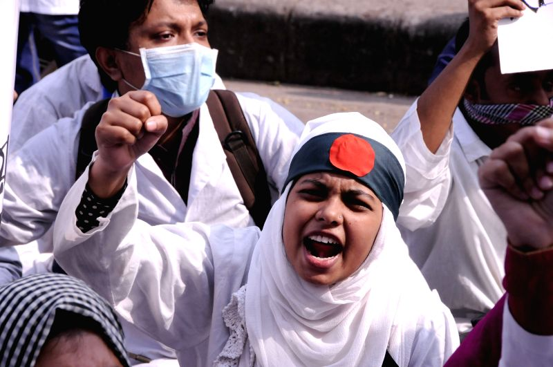 Dhaka (Bangladesh): A student of BSc in Health Technology (Dental) shouts slogans during a demonstration in front of the National Press Club in Dhaka, Bangladesh, Dec. 7, 2014. Around 300 students ...