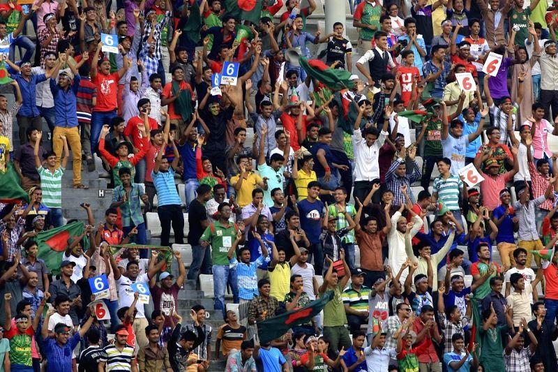 Dhaka (Bangladesh): Fans cheer during the 1st ODI match between India and Bangladesh at Shere Bangla National Stadium in Mirpur, Dhaka, Bangladesh on June 18, 2015.