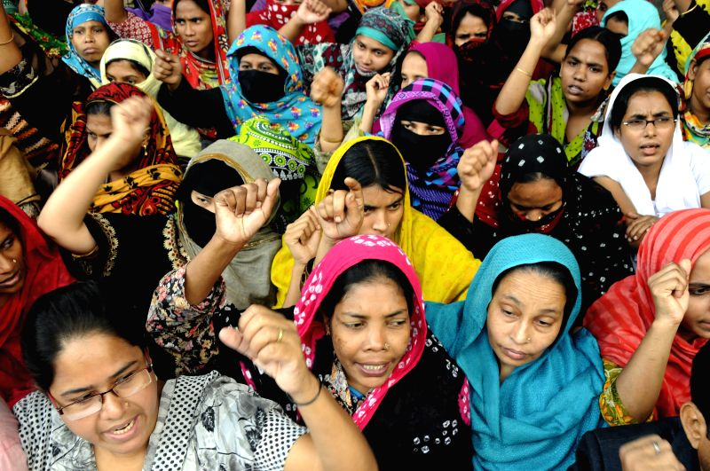 Dhaka (Bangladesh): Garment workers attend a demonstration demanding their due salary in front of the National Press Club in Dhaka, Bangladesh, Dec. 1, 2014. Hundreds of garment workers demanded ...